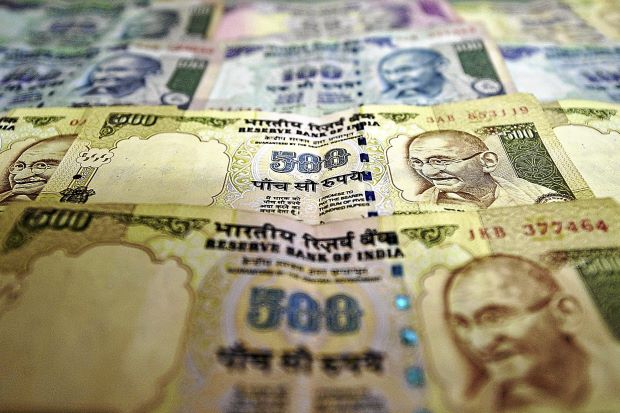 Rupee has hit a record low against the dollar despite recent efforts to prop up the currency photo
