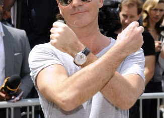 Simon Cowell had secret meeting with Andrew Silverman at New York airport last week in bid to end marriage amicably