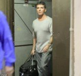 Simon Cowell pictured for the first time since the pregnancy revelations while leaving a television studios in Los Angeles