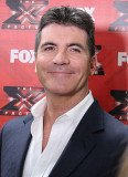 Simon Cowell tops Forbes magazine's list of highest-earning TV personalities in 2012-13 after raking $95 million in just 12 months