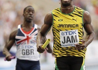 Usain Bolt guided the Jamaican team to victory in the sprint relay in Moscow to become the most successful athlete in the history of the World Championships