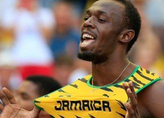 Usain Bolt regained his 100 m world title and won a fourth individual World Championships gold in Moscow