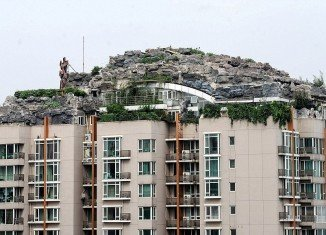 Zhang Lin's villa, surrounded by rocks, trees and bushes, sits on top of a 26-storey building in Beijing's Haidian district