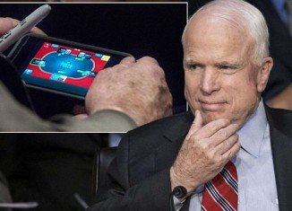 A Washington Post photographer snapped an over-the-shoulder picture of John McCain casually betting play money on his electronic cards, while Syria's fate was the subject of passionate statements and often carefully manicured rhetoric