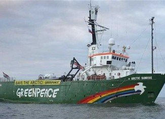 About 15 men in balaclavas seized the Arctic Sunrise ship in the Barents Sea