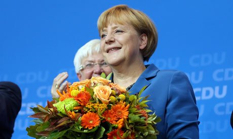 "Angela Merkel has urged her party to celebrate ""a super result"" after exit polls suggested CDU was set to win a third term"