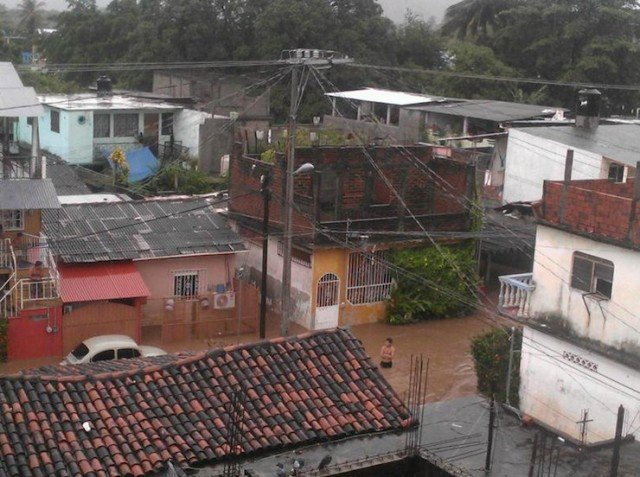 At least 97 people have been killed by storms that hit Mexico