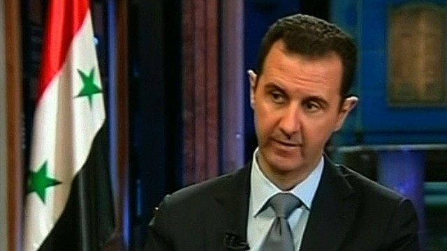 Bashar al Assad has said he is committed to a plan to destroy his countrys chemical weapons but warned it could take about a year photo