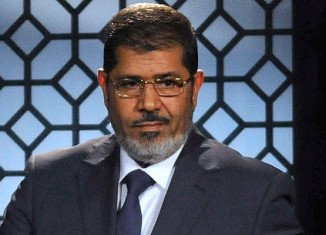 Egypt's state prosecutor announces he has referred ousted President Mohamed Morsi for trial on charges of inciting the murder of protesters