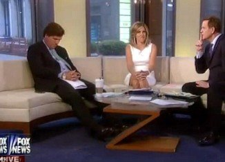 Fox and Friends co-host Tucker Carlson was caught snoozing on live TV