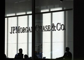 "JP Morgan Chase has agreed to pay four regulators $920 million relating to a $6.2 billion loss incurred as a result of the ""London Whale"" trades"