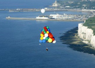 Jonathan Trappe is trying to cross the Atlantic in a lifeboat suspended by some 370 multicolored helium balloons