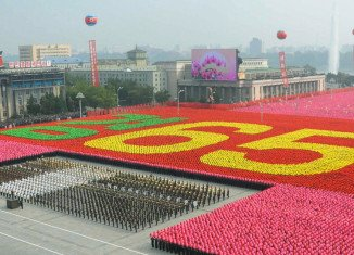 North Korea has marked the 65th anniversary of its founding with a huge military parade