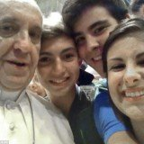 Pope Francis posed for a selfie with young Italian pilgrims in St Peter's Basilica