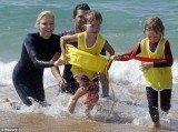 Princess Charlene of Monaco was seen swimming with children in Saint Geours de Maremne in southwestern France