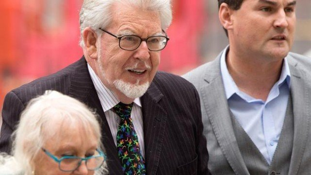 Rolf Harris has appeared in court charged with nine counts of indecent assault
