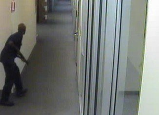 Washington DC Navy Yard gunman Aaron Alexis prowling the corridors of the complex as he hunts for victims