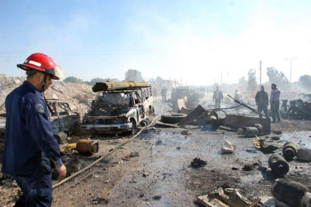 A suicide truck bomb has killed at least 30 people in the central Syrian city of Hama