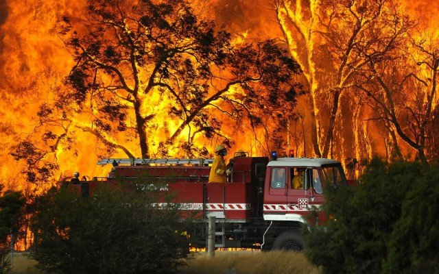 Australian authorities are investigating whether a military training exercise using explosives may have started one of the huge bush fires burning in the state of New South Wales