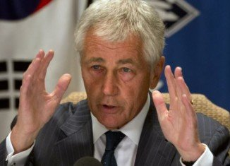 Chuck Hagel has announced that most of the 400,000 US defense department staff sent home amid the US government shutdown have been told to return to work next week