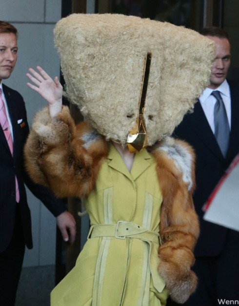Lady Gaga wearing a furry cheese mask in Berlin