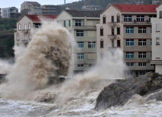 Typhoon Fitow has hit eastern China after triggering the evacuation of hundreds of thousands of people