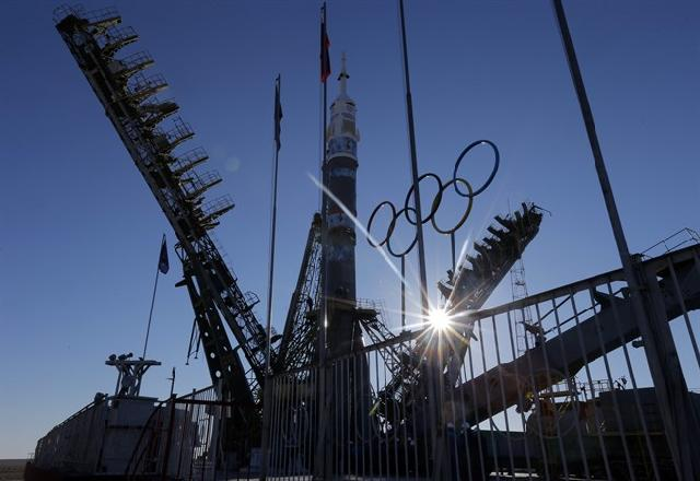 A Soyuz rocket is delivering the Olympic torch to the International Space Station