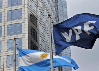Argentina has agreed in principle to compensate Spain's Repsol for the nationalization of energy firm YPF