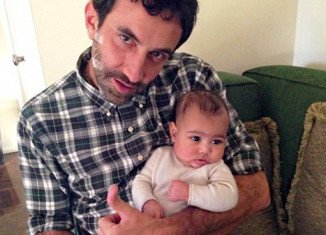Baby North West with Italian designer and stylist Riccardo Tisci