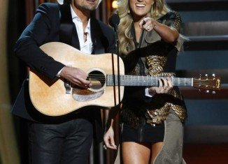 CMA Awards host Brad Paisley and his co-host Carrie Underwood mocked ObamaCare