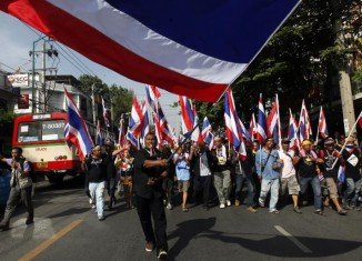 Clashes broke out in Bangkok between rival protesters killing at least one person and wounding other three