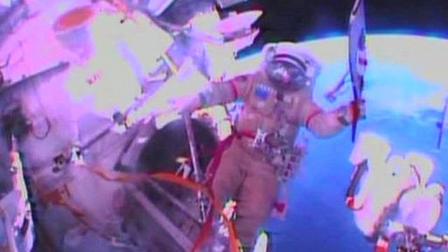 Cosmonauts Oleg Kotov and Sergei Ryazansky are taking the torch for the Sochi Winter Olympics on its first historic spacewalk