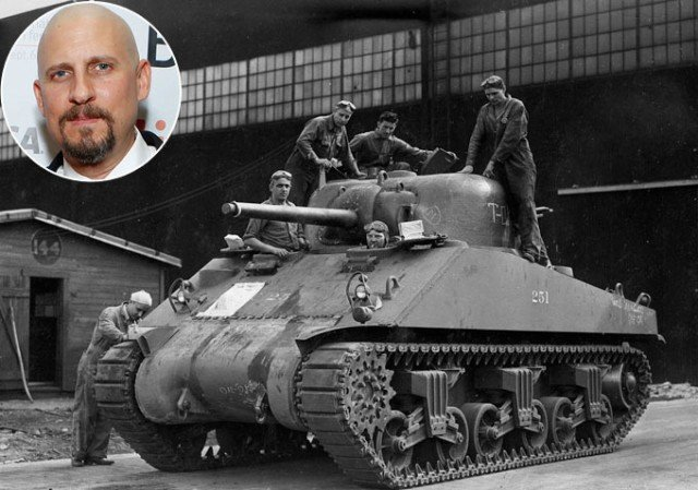 David Ayer has apologized for filming war scenes featuring extras in Nazi uniforms on Remembrance Sunday