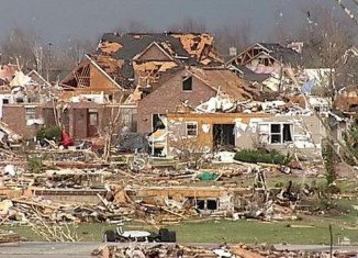 Dozens of tornadoes killed at least six people, injured many others and left devastating damage in parts of Illinois