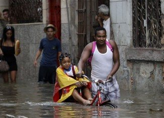 Heavy rain has lashed Cuba since Friday, flooding streets and leaving at least two people dead