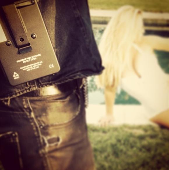 Jessica Simpson wearing a one-piece white bathing suit while gearing up to shoot ads for her Jessica Simpson Collection