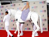 Lady Gaga arrived on the red carpet at the 2013 American Music Awards on top of a fake white horse