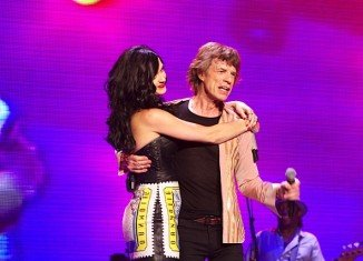 Mick Jagger has denied Katy Perry's claims that he made a pass at her when she was 18