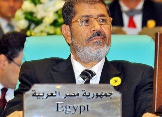 Mohamed Morsi and 14 other Muslim Brotherhood figures face charges of inciting the killing of protesters in clashes outside the presidential palace