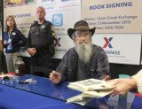 More than 800 people showed up at the PX on Fort Hood to have books signed by Si Robertson
