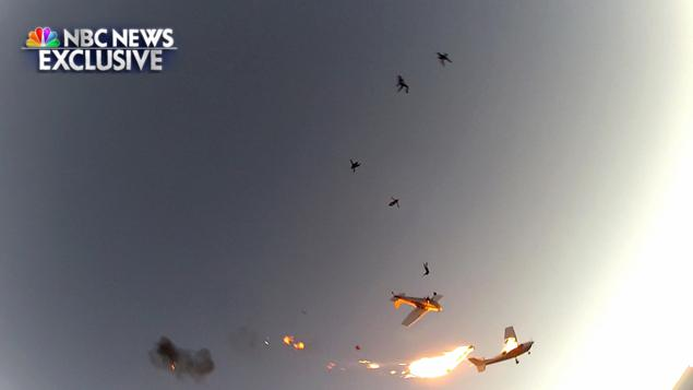 Nine skydivers and two pilots escaped as their planes crashed in midair