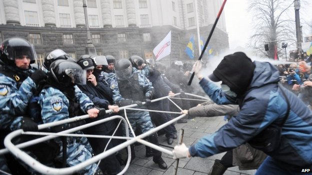 Police fired tear gas as protesters tried to break through a cordon around government buildings