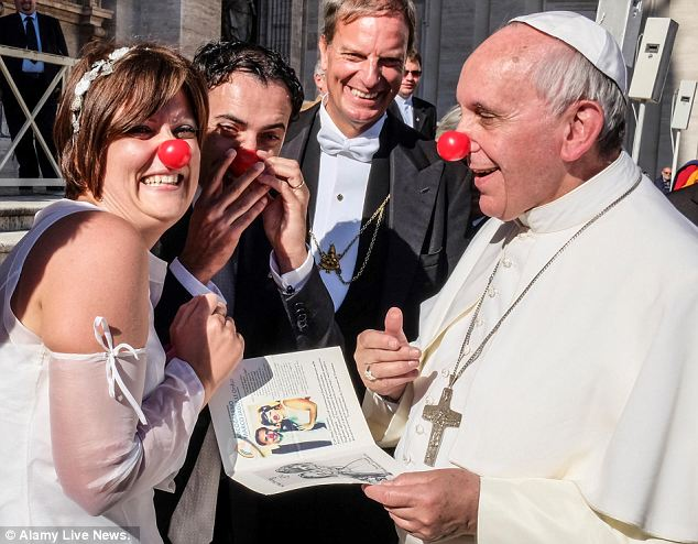 Pope Francis donned a bright red nose and clowned around with a newlywed couple inside the Vatican