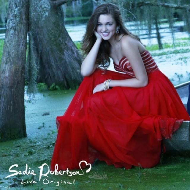 Sadie Robertson wears red Live Original by Sherri Hill prom dress  photo