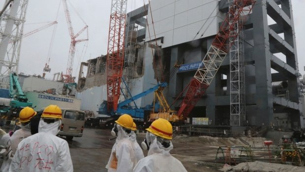 Stricken Fukushima nuclear plant has begun removing fuel rods from a storage pond at the Unit 4 reactor building