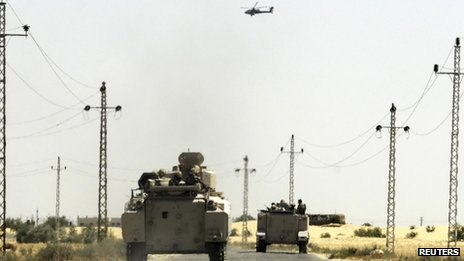 Ten Egyptian soldiers are reported killed and dozens more wounded in a car bomb attack near the North Sinai city of el-Arish
