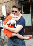 Tom Cruise is suing Bauer over two 2012 tabloid stories that claimed he was absent from Suri's life