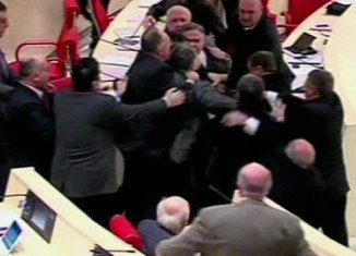 A fight between majority and opposition erupted in the Georgian parliament over plans to support the Ukrainian opposition for European integration