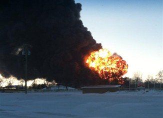 A plume of thick black smoke could be seen many miles away and explosions were heard