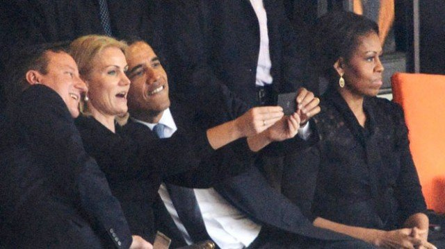 Barack Obama was caught smiling and taking a selfie with Helle Thorning-Schmidt and David Cameron during Nelson Mandela's massive memorial service